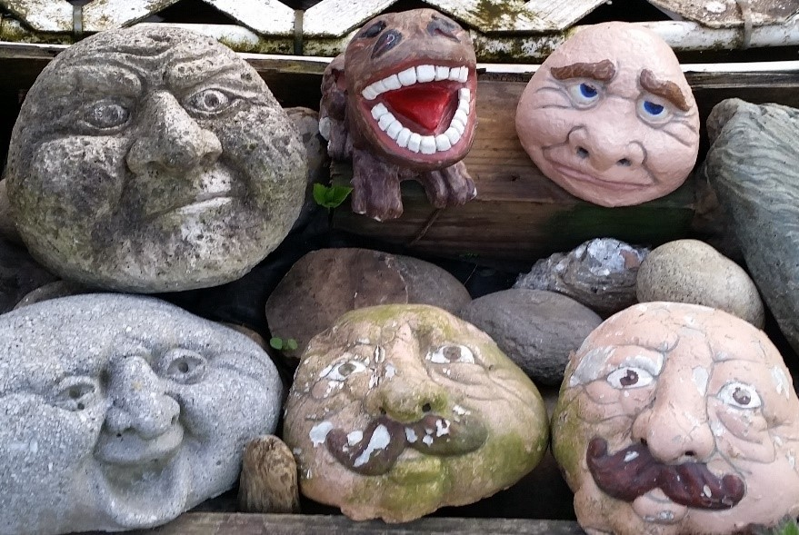 Six round, cement, garden faces