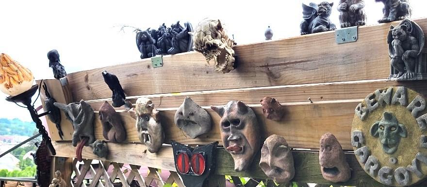 Homemade cement sculptures, collected garden decor, and torch light.